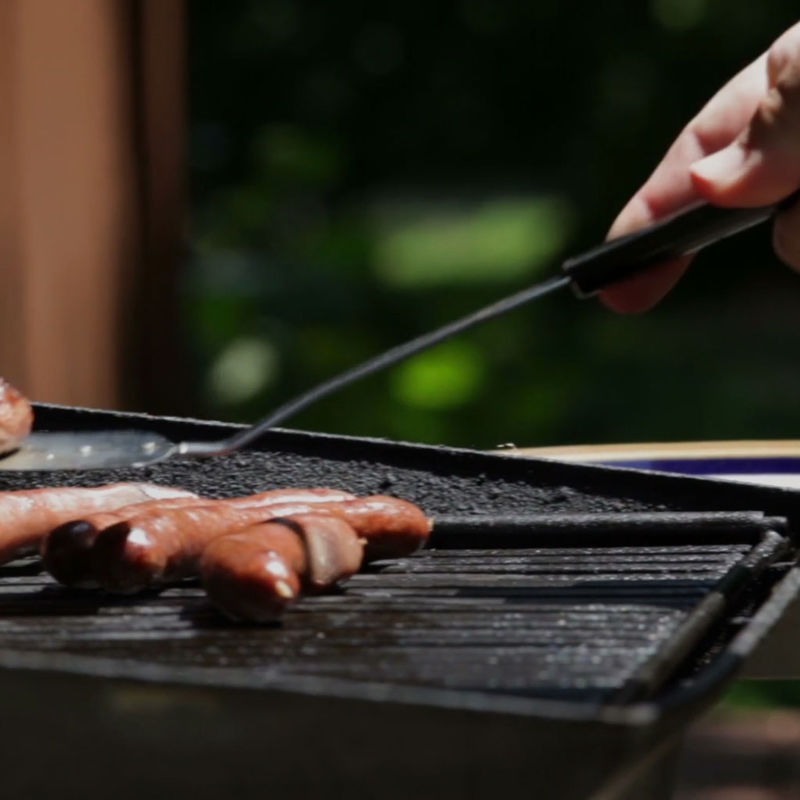 Person Cooking on Outdoor Grill