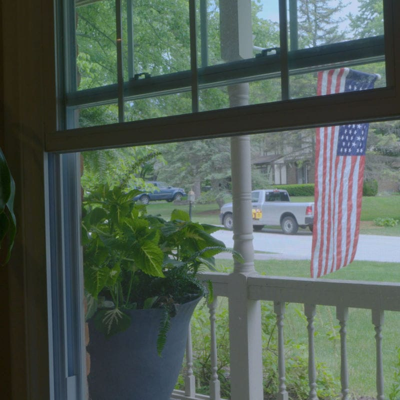 Open Window Looking out at Porch and Street